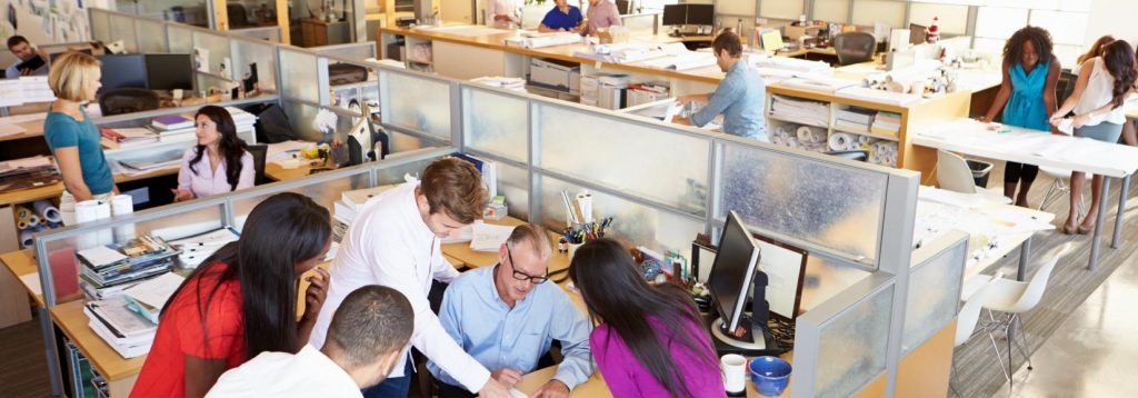 Employees Collaborating In An Office
